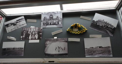 Display case with black & white photographs of campus life